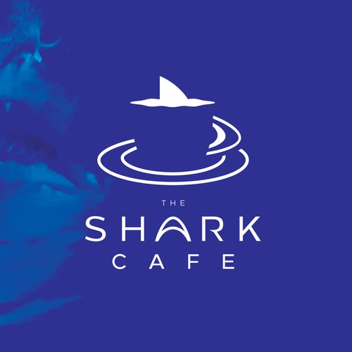 Glass logo with the title 'Shark Cafe'