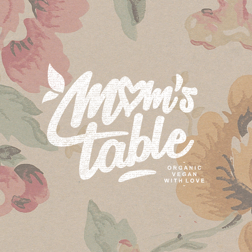 Floral brand with the title 'Handscript-like Mom's Table'