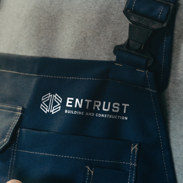 Masculine design with the title 'Logo design for Entrust Building and Construction'