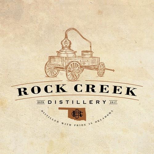 Distillery logo with the title 'Rock Creek Distillery'