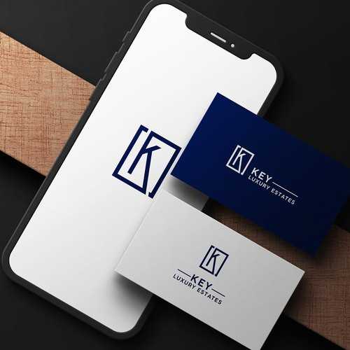 Blue and black design with the title 'Logo for a luxury real estate '