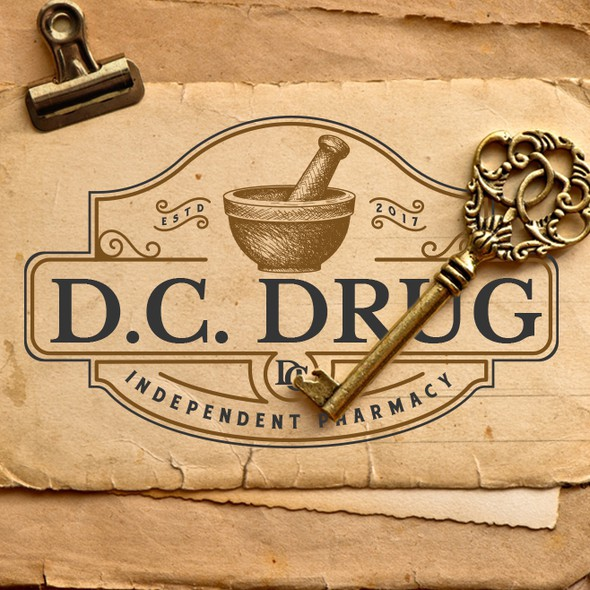 Pharmacy logo with the title 'D. C. Drug'