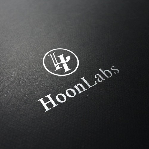 """Genius logo with the title 'H for """"Hoon"""" + L as a tube for """"Labs"""" + arrows up & down for company industry. '"""