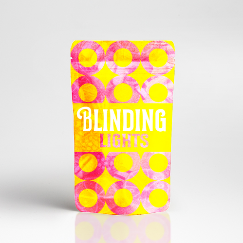 Product packaging with the title 'Blinding Lights Package Design'