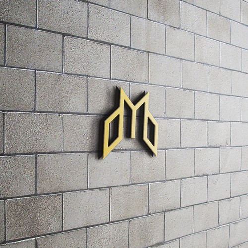 Black and gold logo with the title 'Logo Design for Mining Equities'