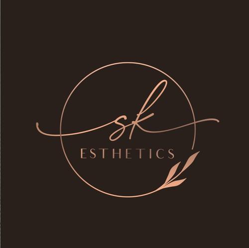 Rose gold design with the title 'Feminine an elegant logo design concept for a high end skin care professional'