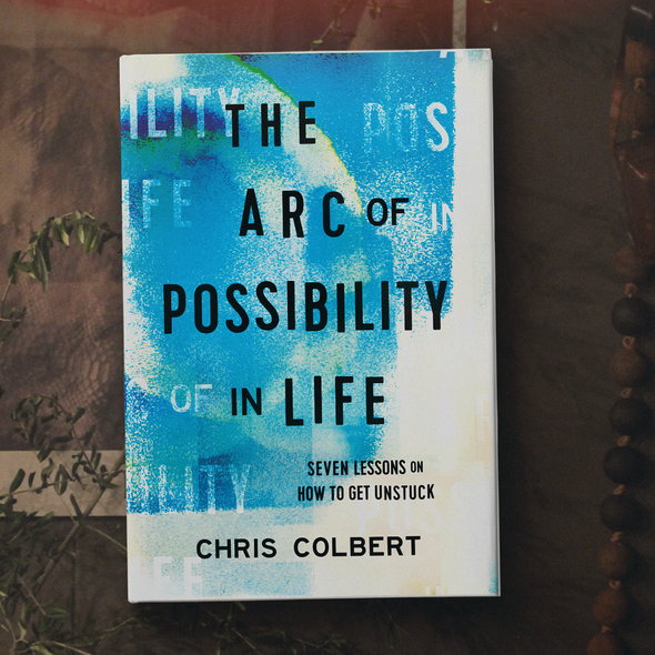 Blue book cover with the title 'The Arc of Possibility'