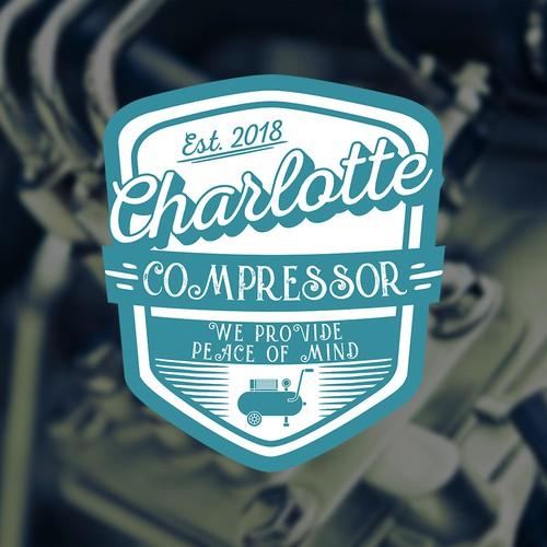 Insignia design with the title 'Charlotte Compressor'