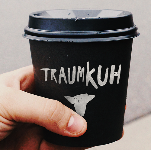 Black design with the title 'Traumkuh'